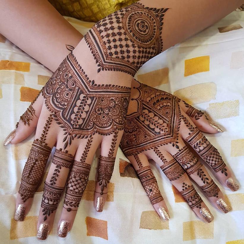 Dainty Back Hand Mehndi Design For Brides