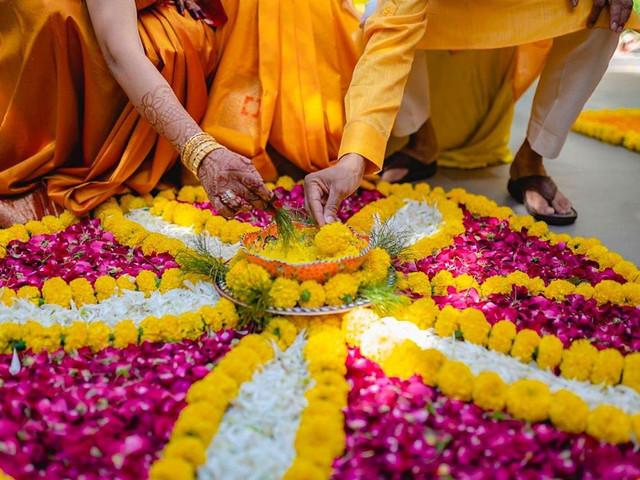 9 Beautiful Flower Rangoli Designs for Your Wedding Venue