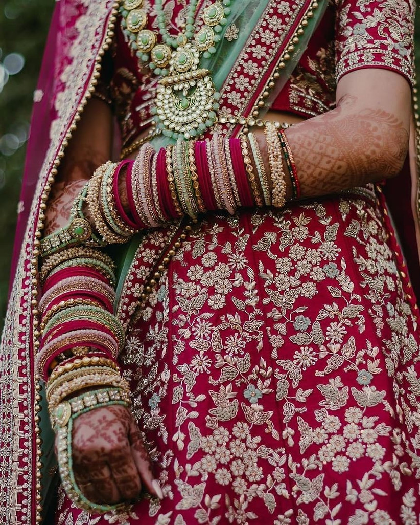 Pink and pastel green chura design for the bride