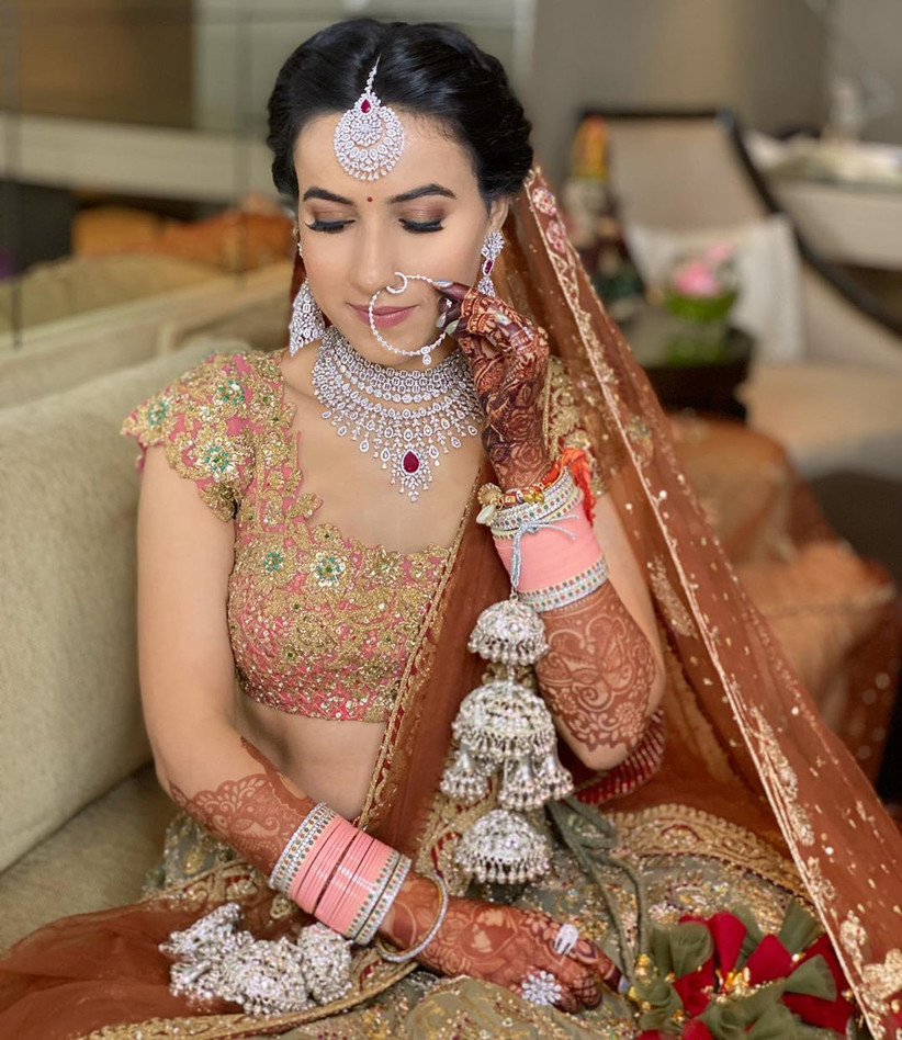 Baby pink and white chura design for the bride