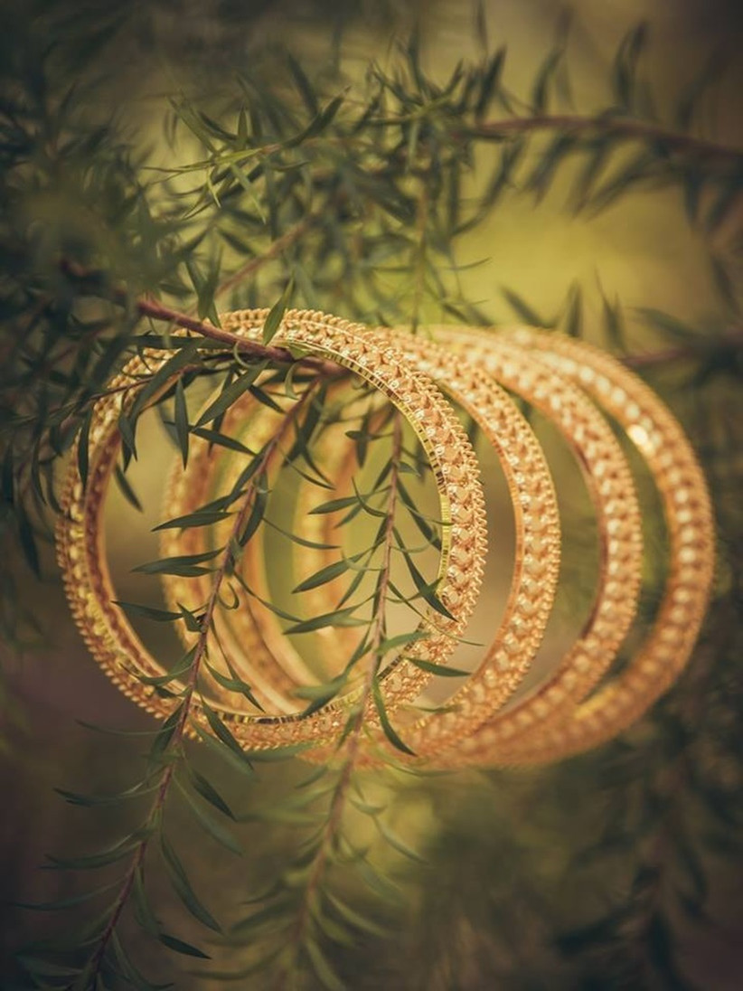 Palakka Bangle comes with leaf motifs and valuable gemstones that enhance the wrist of the Malayali bride.