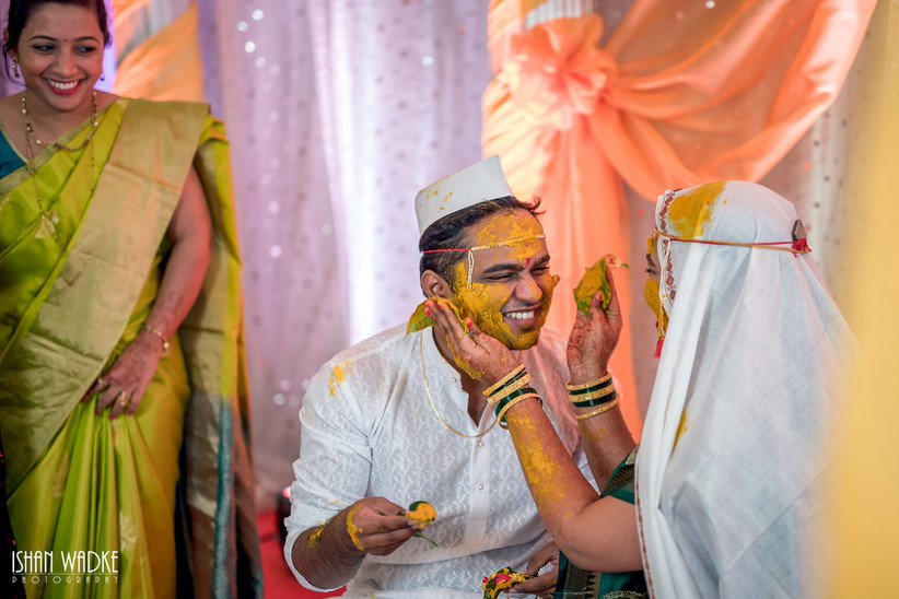The Haldi ceremony is one of the most interesting Maharashtrian wedding rituals where the bride and groom are smeared with Turmeric paste.