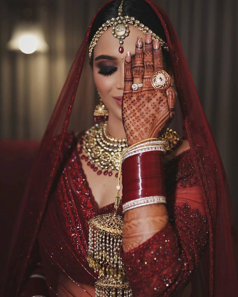 classic red chura design for the bride
