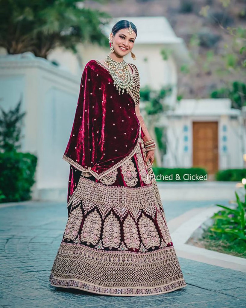 02b6693576 Take Inspo from These 12 Stunning Blood Red Bridal Lehenga Images ...
