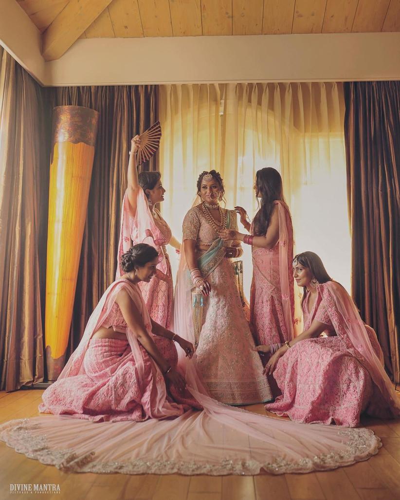 Bridesmaid posing with the bride