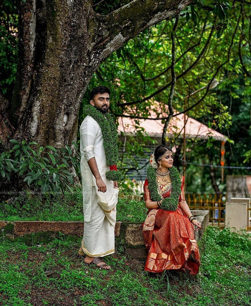 Couple posing in South Indian Outfits