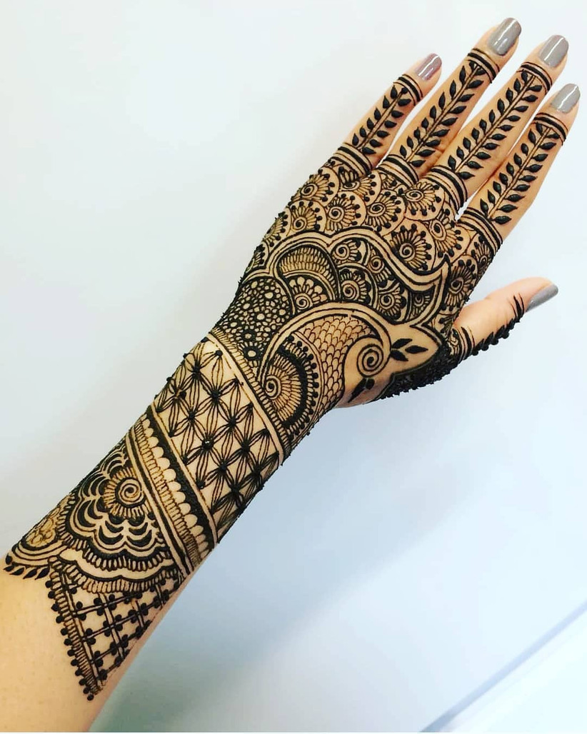 unique peacock mehndi design