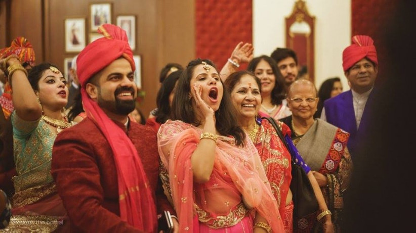 Wedding reception in the Jain community is a grand function with families and friends having great fun together.