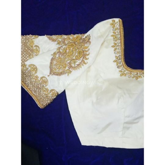 Ivory and gold blouse