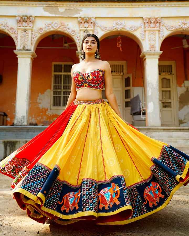 How do you like this multi-hued lehenga topped with a corset blouse? 😍 - 1